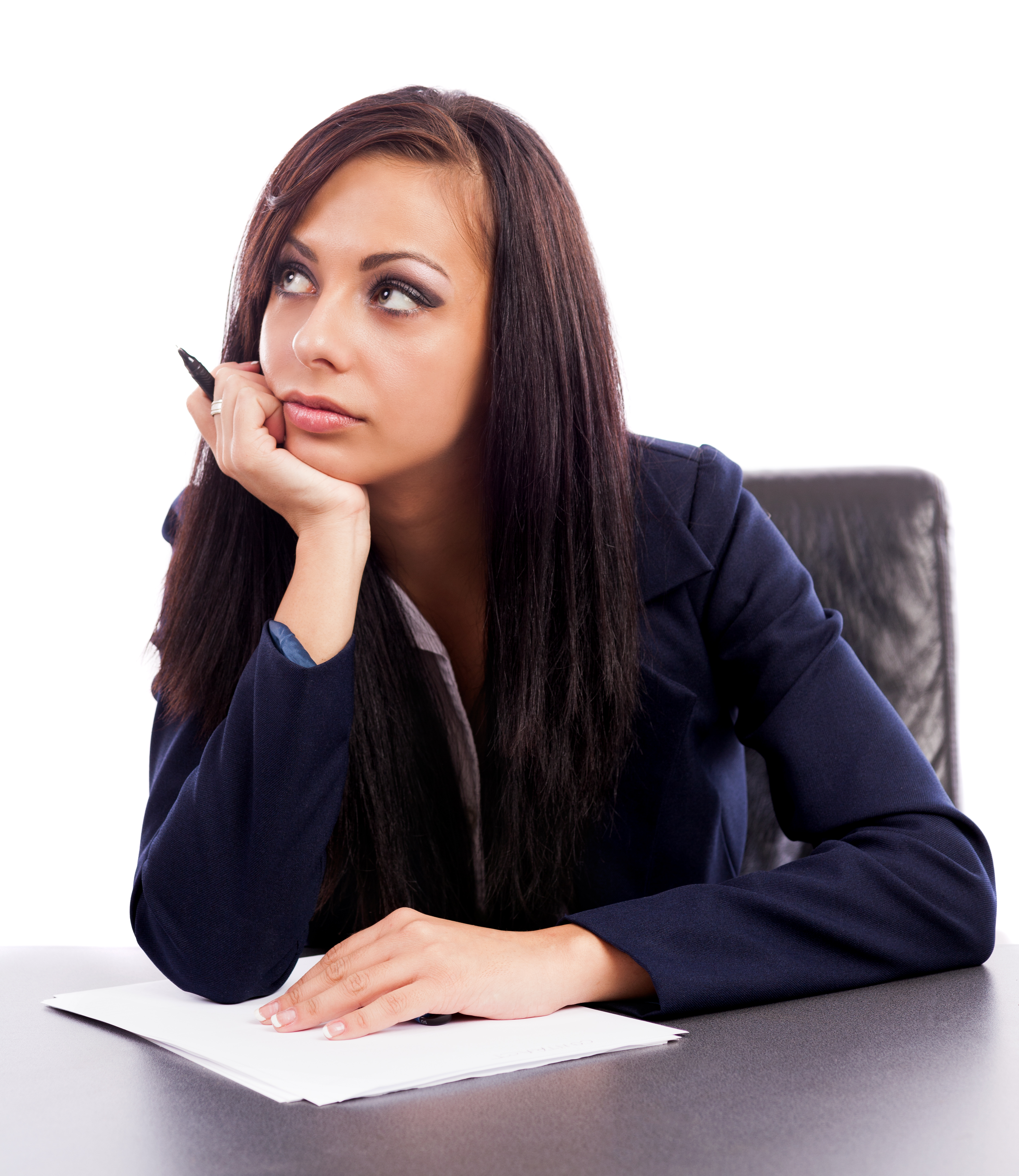 Latin businesswoman thinking while sitting at desk